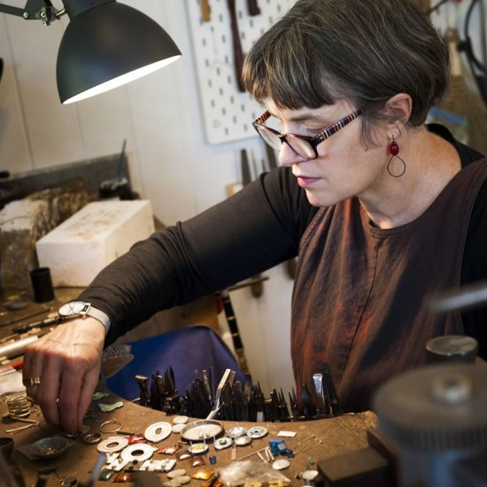 Artist, Catherine Large, in the studio working on the car wreck pieces